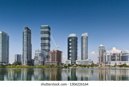 Waterfront skyline with construction of residential high rise buildings on blue sky