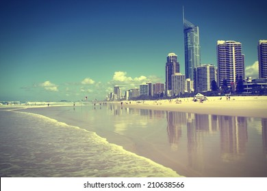 Waterfront skyline with famous Q1 skyscraper - Surfers Paradise city in Gold Coast region of Queensland, Australia. Cross processed color tone - retro filtered style.