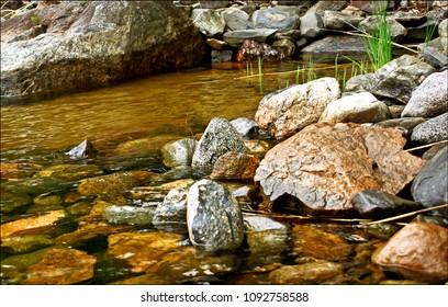 Waterfront stones at lake Saimaa