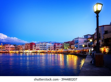 waterfront of venetian habour of Chania with  Aegan sea at night, Crete, Greece, toned