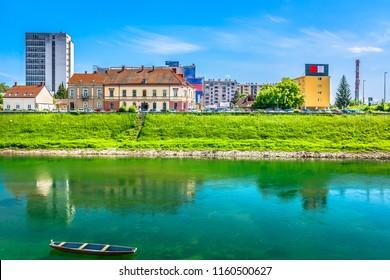 Waterfront view at Karlovac coastline town in Croatia, Korana river scenery. / Selective focus.