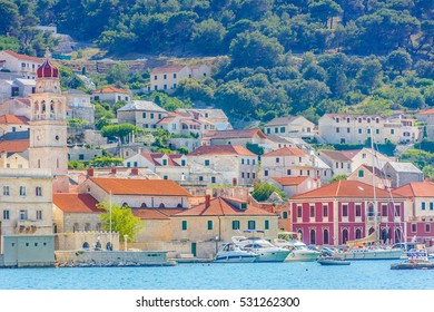 Waterfront view at small picturesque mediterranean town Pucisca, Island, Brac, Croatia Europe. / Pucisca town island Brac. / Selective focus.