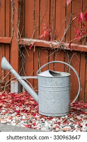 Watering can outside in the autumn