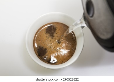 Watering coffee with hot water