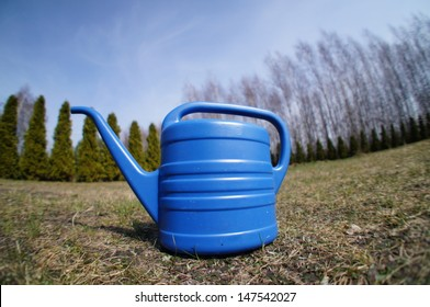 Watering flowers in the garden with watering can