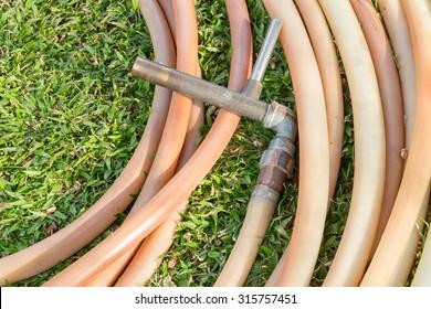 Watering garden hose put on the garden