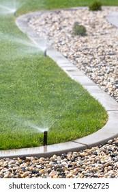 watering lawn with sprinklers