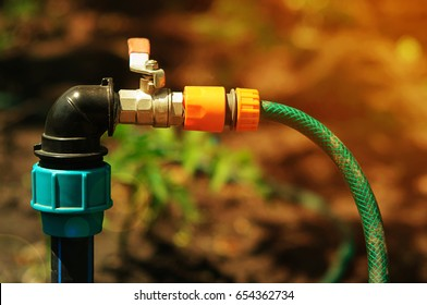 Watering tap. A tap with a hose in the garden. Water consumption.