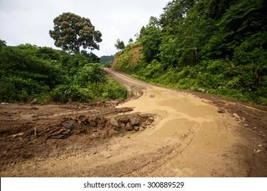 Waterlogged Dirt Road Leading Through Chin State Mountainous Region, Myanmar (Burma)
