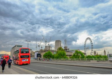 Waterloo Bridge, London, England - May 2, 2017:  View of the road on Waterloo Bridge, with bues,  the London Eye and lots of cranes.
