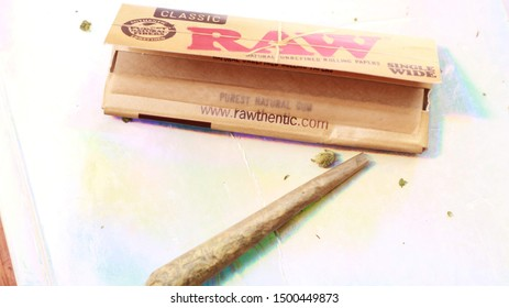 Waterloo, Ontario Canada, July 04, 2019 Raw Rolling papers Classics, With Rolled Joint of Cannabis, Gelato BC Bud,