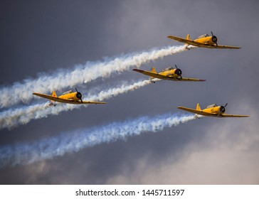 Waterloo, Ontario/Canada - July 8, 2019: Canadian Harvards fly in formation at the Waterloo Airshow. The aircraft is a part of the Canadian Air Force Heritage Flight.