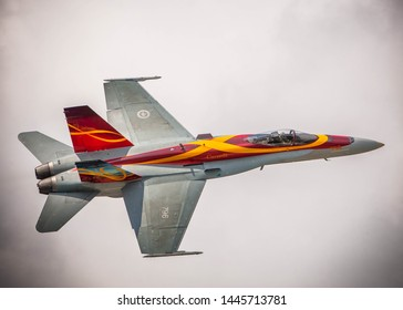 Waterloo, Ontario/Canada - July 8, 2019: Canadian Fighter Jet CF-18 flies over the Waterloo Airshow. The aircraft is a part of the Canadian Air Force Heritage Flight.