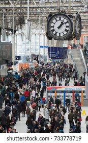 Waterloo Station London January 2017. View from above looking at large crowd of commuters waiting for train in foyer because of delay on rail network