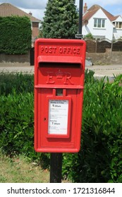 Waterlooville, Hampshire/England - July 12 2019: Vintage Royal Mail small red  Post Box on pole