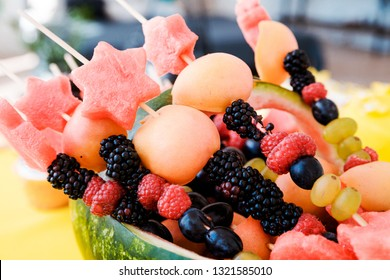 Watermelon basket filled with fruit. Horizontal photo