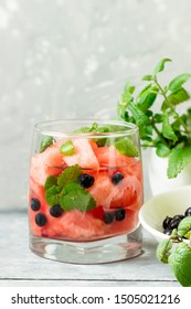 Watermelon and  blueberries drink in glasses with mint. Ice cold summer cocktail or lemonade in glass.