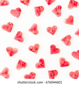 Watermelon cut into heart shape. Flat lay composition on white background. Love pattern concept.