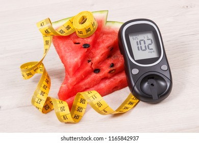 Watermelon, glucose meter with result of sugar level and tape measure, concept of healthy lifestyles, nutrition and slimming