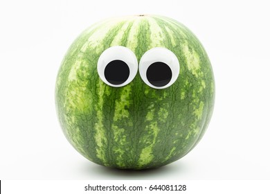 watermelon with googly eyes on white background - watermelon face