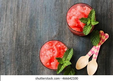 Watermelon Granita topped with mint leaf, overhead view