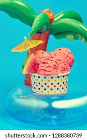 watermelon ice cream with tropical umbrella over palm holder floater