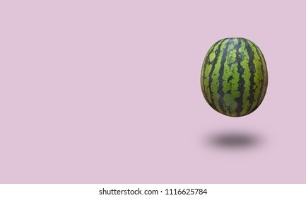 Watermelon isolated on a pastel background with a shadow. Horizontal orientation with copy space