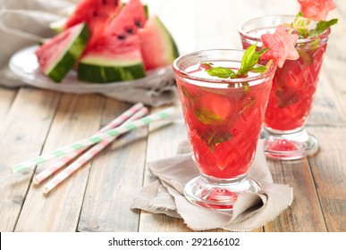 Watermelon juice with mint and ice on wooden rustic  table.