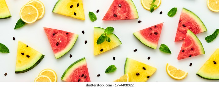 Watermelon, lemon colorful pattern background. Fresh red yellow watermelon slices, citrus wallpaper, top view. Lemonade creative concept, fashionable trendy summer beverage, flat lay
