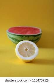 Watermelon and lemon isolated on colorful, yellow background