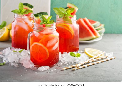 Watermelon lemonade in mason jars with lemon