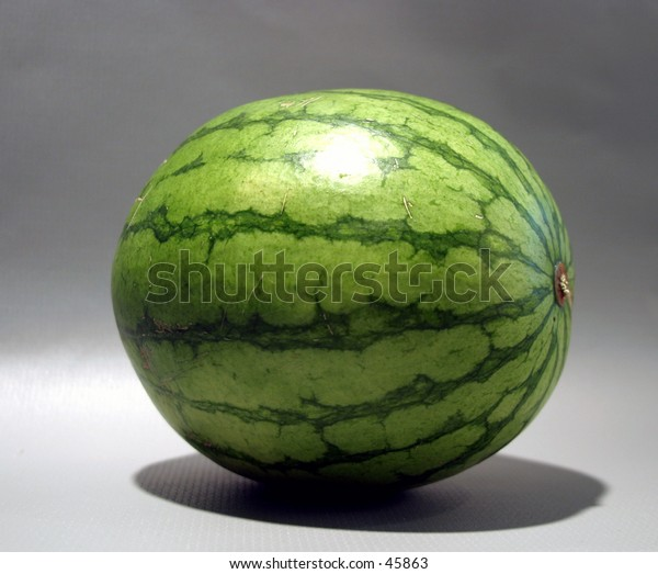 a watermelon on a gray background