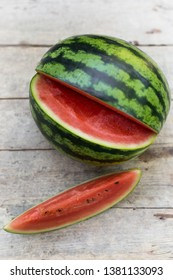 watermelon on a wooden table, piece of melon topview
