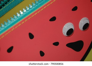 Watermelon pencil case with googly eyes.