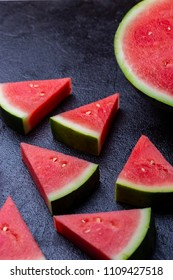 watermelon pieces in a black background