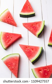 watermelon pieces in a wooden background
