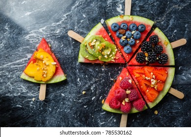 Watermelon pizza - slices with berries and fruits, granola. Fresh low carb diet. Healthy lifestyle concept. Top view