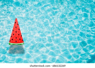 Watermelon pool float, ring floating in a refreshing blue swimming pool