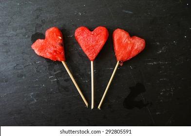 Watermelon Pops. Watermelon slices cut into heart shape pieces.