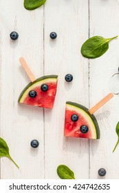 Watermelon popsicle. Funny watermelon slices on sticks. Top view, flat lay