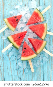 watermelon popsicle raw food yummy fresh summer fruit sweet dessert on vintage old wood teak blue flat lay