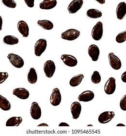 Watermelon seeds isolated on white background. Flat lay. Black seed Pattern. Food concept. Close up