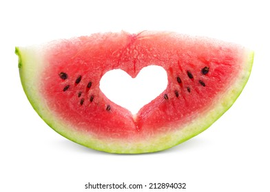 Watermelon slice with cut in the shape of heart on white background