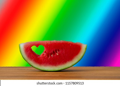 Watermelon slice with a heart. Conceptual image for enjoying summer.