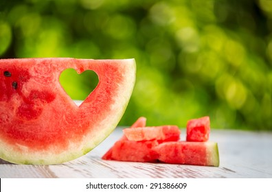 Watermelon slice with heart shape hole, concept summer love