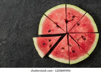 Watermelon Slice and Mint on Dark Stone Table. Summer Background. Top View Flat Lay. Copy Space For Your Text