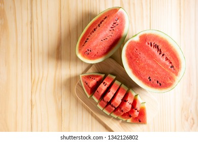 Watermelon sliced on wooden background, top view