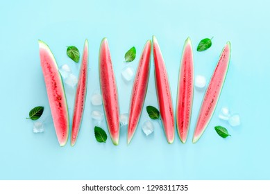 Watermelon slices with ice and mint,  summer heat cooling food concept, flat lay composition