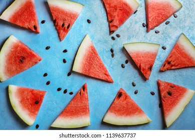 Watermelon slices on a  blue rustic wooden  background, flat lay