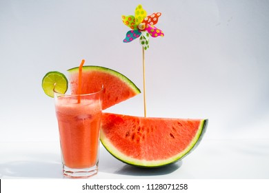 watermelon smoothie on white background, and windwheel